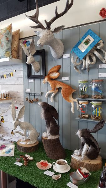 Papier Mache Hares on display at Whitefriars Food & Craft Market pop-up shop in Canterbury