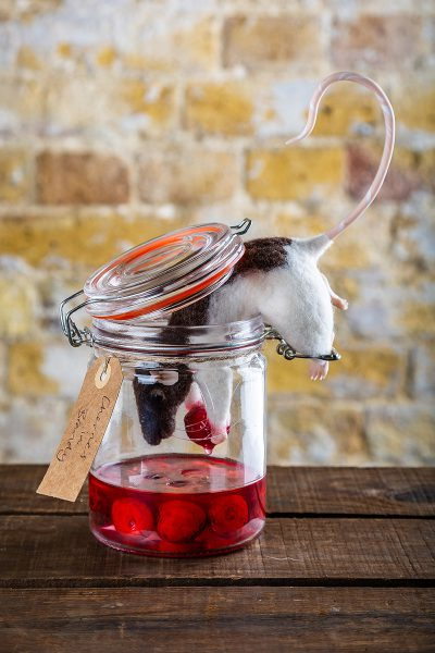 These are artificial cherries set in resin