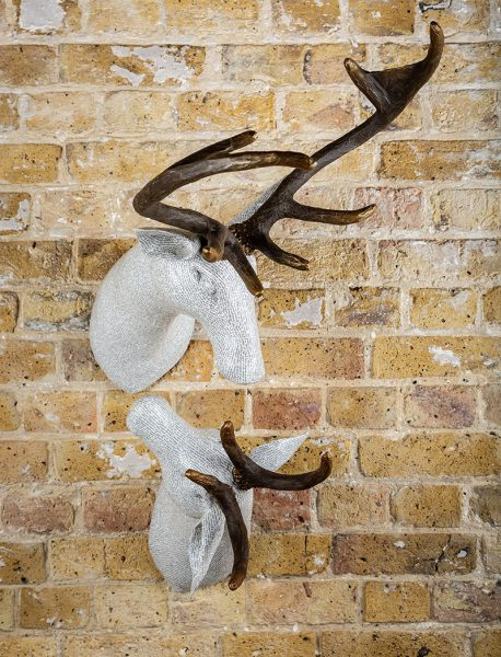 The Antlers are painted, with the main bodies covered in a layer of fine book print