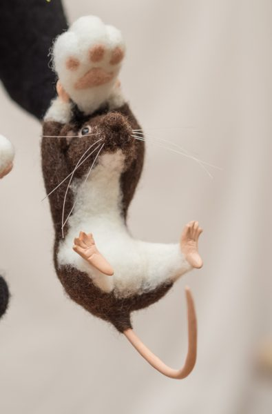 needle felted rat hanging on to Sam's foot